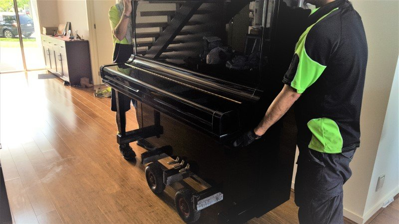Upright piano removals and dolley.