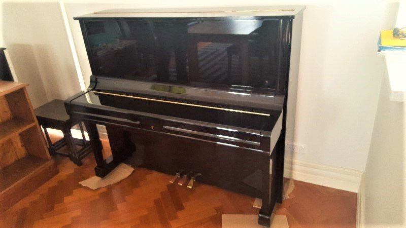 Upright Piano Removals and Polished floor boards.