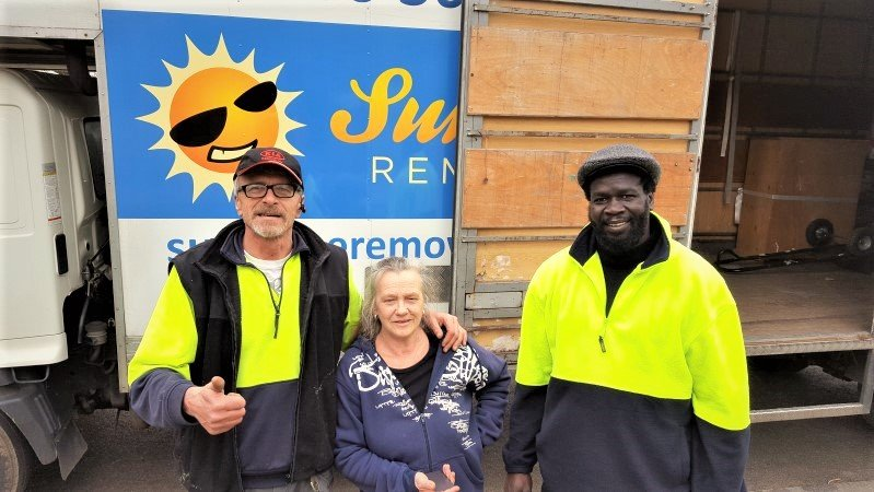 Happy customer and two Sunshine removalists.