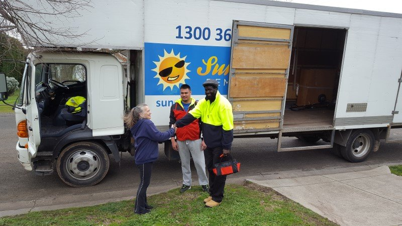 lady shaking hands with our melbourne movers
