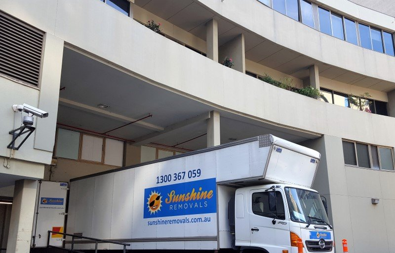 Sunshine furniture removalists truck and a Hi Rise apartment