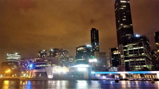 Melbourne city movers at night the Yarra and city background.