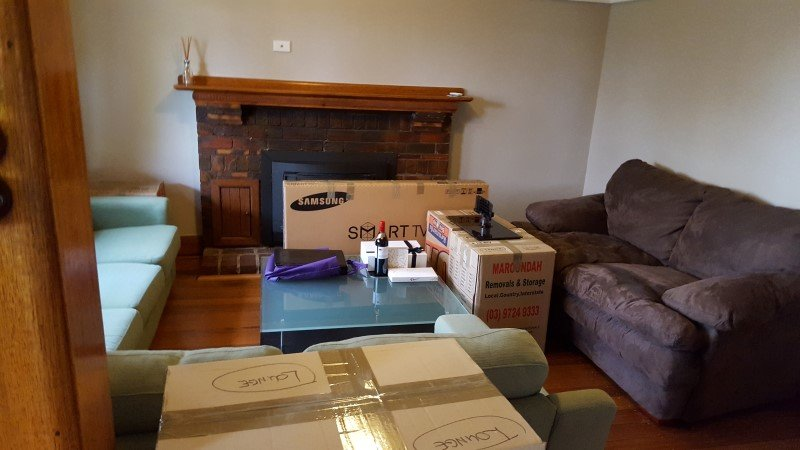 House packing a lounge room with boxes.