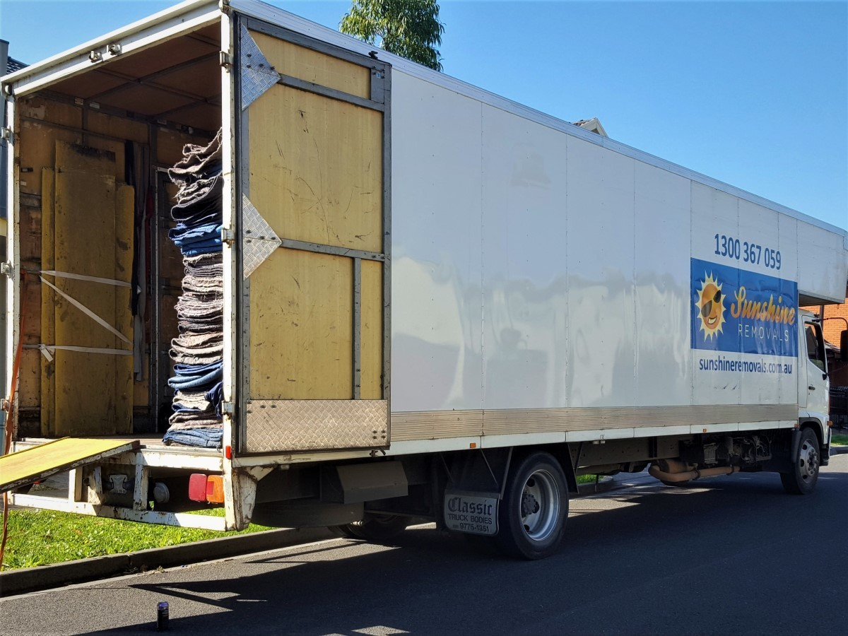 Sunshine removalists truck. moving furniture new home.