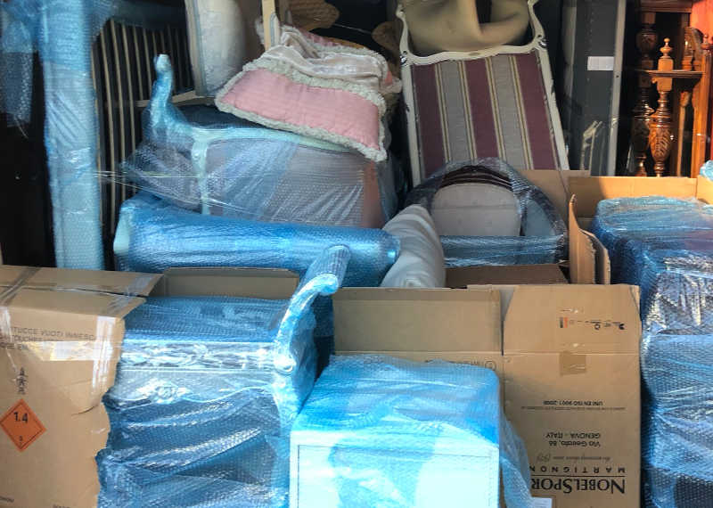Home Removals melbourne packing a container to Vic Country